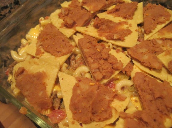Pre heat oven to 350 degrees. Take your corn tortilla wedges and spread with...