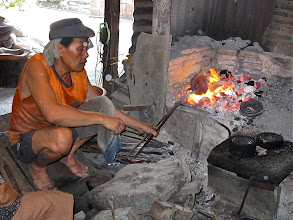 Photo: heating up a  chunk of bronze alloy, Ban Pu village along Bangkok Noi canal