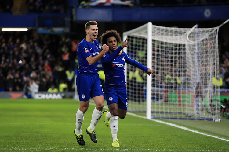 Willian, right, celebrates with Cesar Azpilicueta after scoring Chelsea's first goal against Sheffield Wednesday on Sunday. The Brazilian scored twice in a 3-0 FA Cup Fourth Round win for Chelsea.