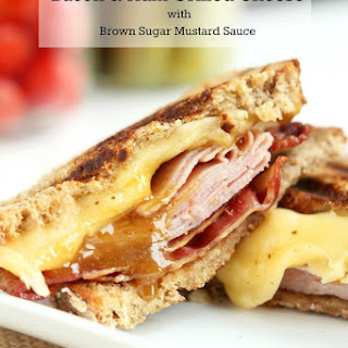 Bacon, Ham and Grilled Cheese Sandwiches with Brown Sugar Mustard Sauce.