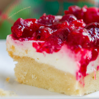 Cranberry Cheesecake Dream Bars with an Almond Shortbread Crust.