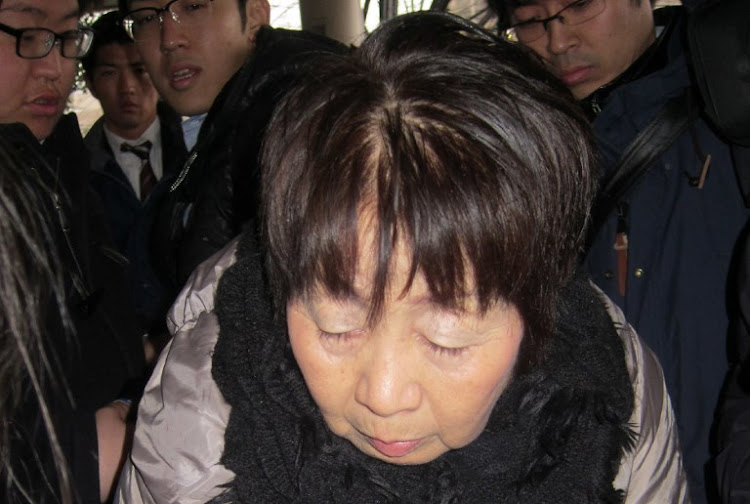 "This file photo taken on March 13, 2014 shows Japanese woman Chisako Kakehi, who was arrested on suspicion of poisoning her husband with cyanide in the latest ""Black Widow"" case, arriving at the Kyoto district court."