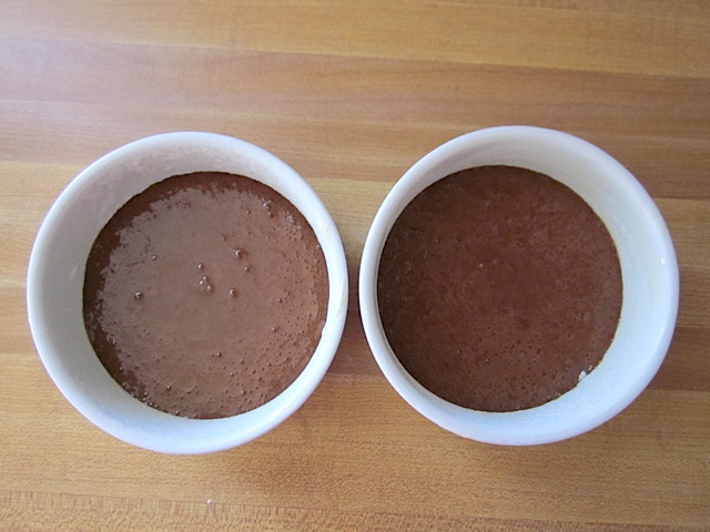 cake mixture poured into two ramekins