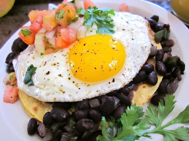 huevos rancheros plated on white plate