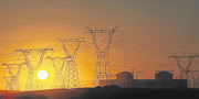 A view of the setting sun through the pylons of the Koeberg nuclear power station near Cape Town.
