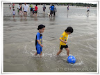 pasha and nadim playing beach soccer