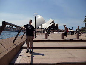 Travis standing in front of the Sydney Opera House.