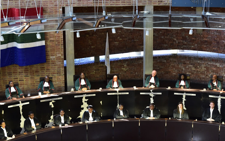 The Constitutional Court has ruled on whether a group of workers should have been fired for singing 'hit the boer'.
