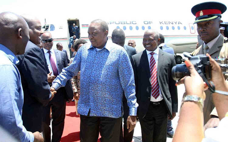 ANC deputy president David Mabuza welcomes Kenya's President Uhuru Kenyatta at the East London Airport. Picture: MICHAEL PINYIN