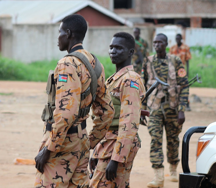 South Sudanese policemen and soldiers stand guard. Picture: REUTERS