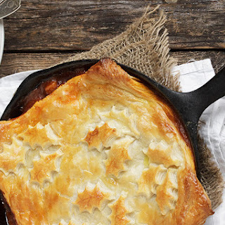 Skillet Beer-Braised Beef and Vegetable Pie with a Puff Pastry Topping.