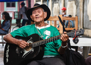Photo: We met this chap in Baracoa, Cuba. This was our first real day in Cuba so we were perhaps a bit unsure at first, but it quickly became obvious that the locals were genuine, loved to sing and play, and had years and years of practice! Despite his age and him having few or no teeth, this guy had an amazingly strong voice. We didn't realise at the time but it turned out to be one of the best we heard in the whole country.  I don't know his name, but if anyone reading this ever makes it to Baracoa, please track this guy down, buy him a drink and say hi :)  #WeLoveMusicWednesday, curated by +Folletto Folletto and +Harmony Goodson