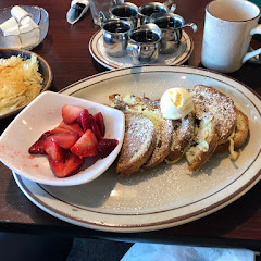 Gluten Free French Toast with strawberries and hash browns.