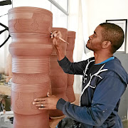 Ceramic artist  and entrepreneur Chuma Maweni is putting final touches to one of his grand creations.
