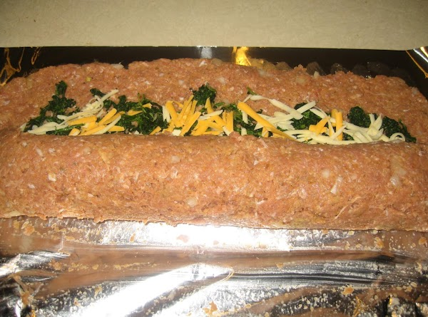 Roll up rectangle carefully,beginning at 8 inch side and using foil to lift it.
