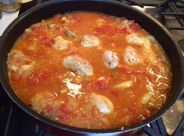 Add chicken pieces back into skillet.  Lower heat to a simmer, cover skillet,...