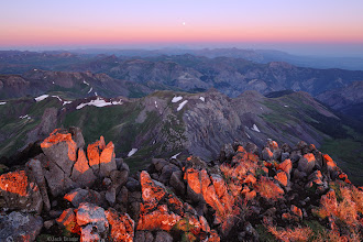 Photo: Sunrise over the San Juans, as seen from the summit of Wetterhorn Peak. At 14,015 ft. the summit rocks of Wetterhorn are lit by the sunrise alpenglow light before the earthshadow has even dropped below the horizon!