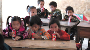 Kids enjoying donated milk and eggs