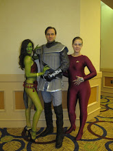 Photo: Poor poor Klingon, surrounded by Orion Slave Girl and Seven-of-Nine