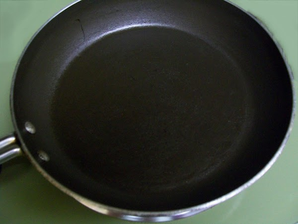 Coat a skillet with cooking spray. Heat skillet over medium heat until hot.