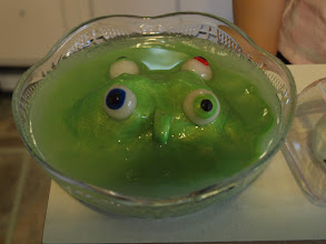 Photo: Lime sherbet monster punch. The bowl came from Dollar Tree. We filled the bowl with ice (Poly-Pellets) and added a monster, made from polymer clay, then we poured green quick water.
