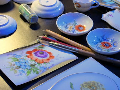 Ceramics being hand painted at the ITB Berlin Travel Trade Show in Germany