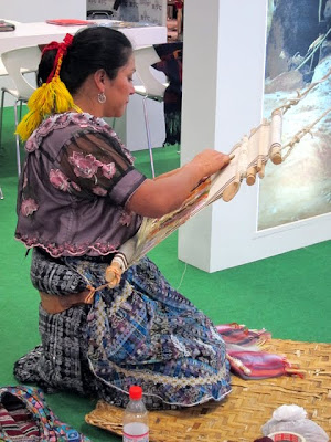 Woman weaving at the ITB Berlin Travel Trade Show
