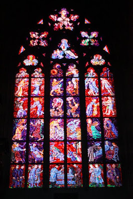 Stained glass window in St Vitus Cathedral in Prague Czech Republic
