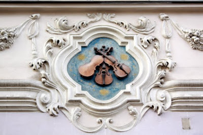 Violins above a shop in Prague Czech Republic