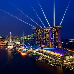 Laser Battle by Justin Ng - City,  Street & Park  Vistas ( justin ng photo, blue hour, mbs, laser show, singapore flyer, marina bay sands, artscience museum, museum, justin ng, laser battle, watershow, singapore )