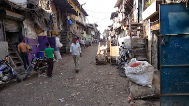 Photo: Dharavi slum; one of the biggest in Asia, as seen in Slumdog Millionaire.  This slum has thriving businesses of all sorts.  Millions are made from recycling, manufacturing, etc., and it has full schools systems.  But living conditions are incredibly poor.  Residents mostly *choose* to live here, and have turned down offers from the govt to tear down the slums and replace with more suitable housing.Read: http://en.wikipedia.org/wiki/Dharavi