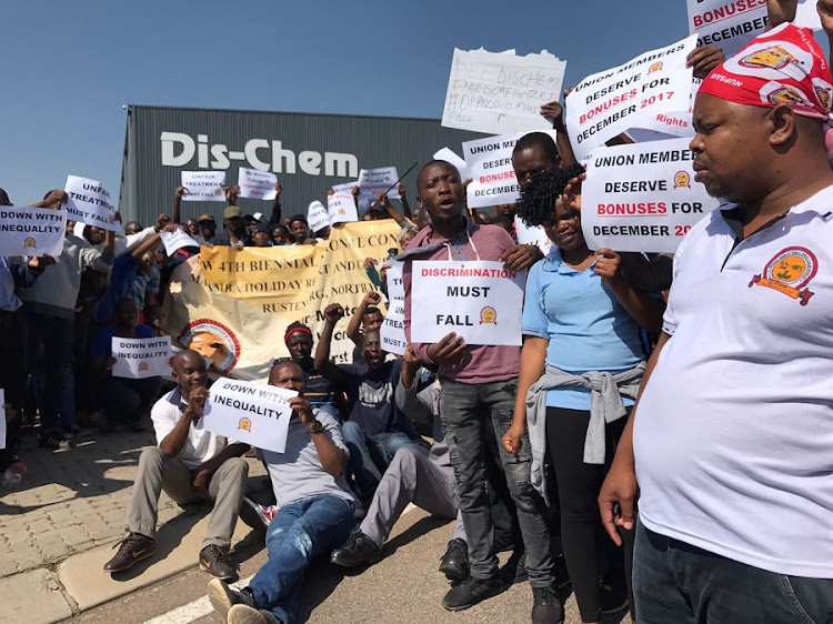 Picket protest by workers affiliated to the National Union of Public Service and Allied Workers (Nupsaw) outside Dis-Chem's warehouse in Midrand. Picture: BAFANA NZIMANDE