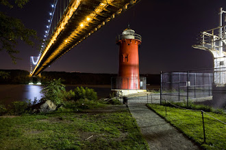 "Photo: One more tonight for +Levi Moore's #topphotos2011. This shot of the ""Little Red Lighthouse"" - actually the Jeffrey's Hook Light - and the underbelly of the George Washington bridge was taken on a pleasant September night when the rarest of conditions was present in New York City - the view was clear for miles. I don't know whether some gust of wind just blew the smog elsewhere for long enough to take a couple of exposures of this scene and in other parts of the park, but for whatever reason, there's no light pollution, no haze, and everything from that evening came out brilliantly."
