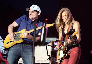 Photo: INDIO, CA - APRIL 29:  Musicians Brad Paisley (L) and Sheryl Crow perform onstage during the Stagecoach Country Music Festival held at the Empire Polo Field on April 29, 2012 in Indio, California.  (Photo by Christopher Polk/Getty Images for Stagecoach)