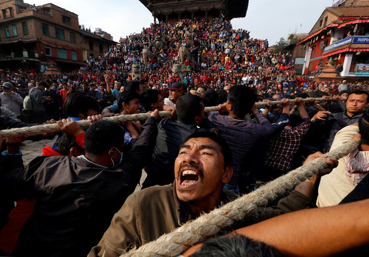 Devotees pull the chariot of God Bhairab during the Biska Festival also known as Bisket Festival in Bhaktapur, Nepal.