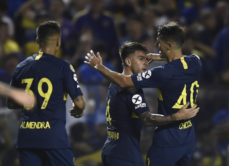 Julio Buffarini of Boca Juniors celebrates with teammates after scoring the fourth goal of his team during a match between Boca Juniors and Tigre as part of Superliga 2018/19 at Estadio Alberto J. Armando on November 3, 2018 in Buenos Aires, Argentina.