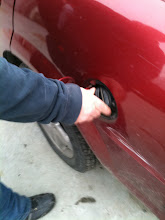 Photo: Mike: Step 4: Put the gas cap back on. You're done.