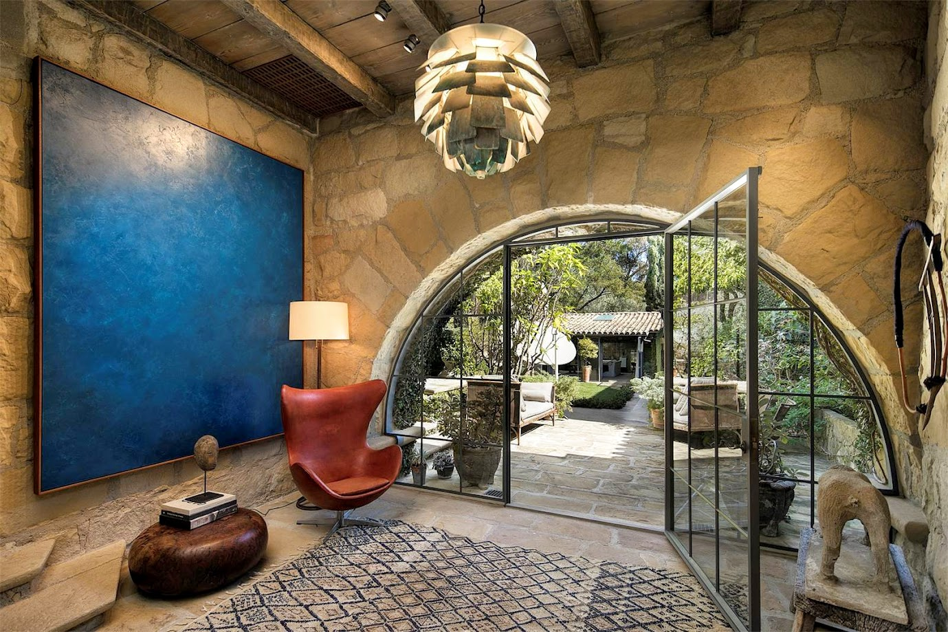 Before originally ellen used french antiques in this foyer