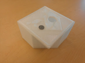 Photo: Hank printed a whole fucking birdhouse in two pieces. Quarter for scale.