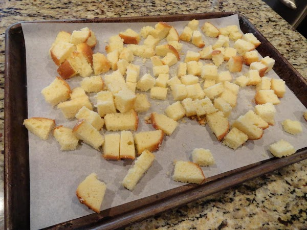 Cut pound cake into 1 inch cubes and place in a large bowl or...