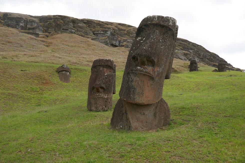 Moai partially buried on the side of Rano Raraku