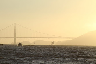 Photo: The bridge and boats look pretty silhouetted against the golden sky.