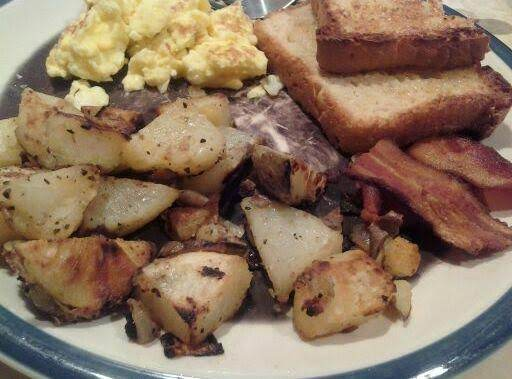 Easy Breakfast Potatoes, English Muffin Bread, Scrambled Eggs And Bacon.