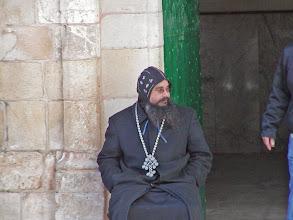 Photo: A monk at the church