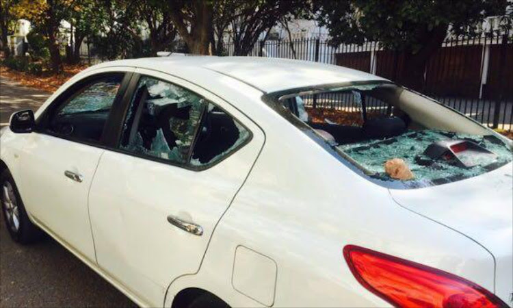 One of the vehicles damaged in the alleged altercation between Uber drivers and metered cab drivers outside the Gauteng Station in Sandton, Johannesburg on 20 May 2016.