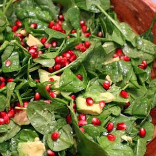Spinach, Avocado, Pomegranate Salad with Warm Vinaigrette.