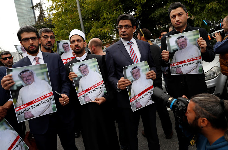 Human rights activists and friends of missing Saudi journalist Jamal Khashoggi held his picture during a protest outside Saudi Arabia's consulate in Istanbul, Turkey on Saturday.