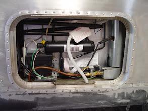 Photo: installed refrigerator through access door opening