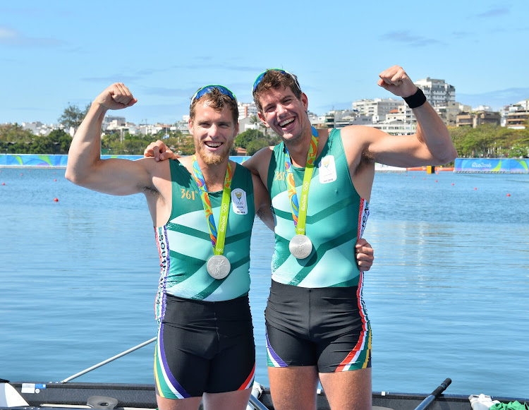 SA champion rowers Lawrence Brittain (L) and his partner Shaun Keeling (R) celebrate after winning silver in the men's pair during the Olympic Games Rowing Events in Rio de Janeiro, Brazil in July 2016. File photo