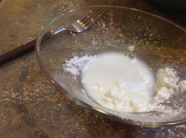 Combine corn starch and 1 tablespoon of water together in a small bowl to...